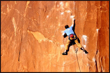 Rock climber on red face