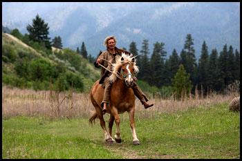 Lynx Vilden on horseback