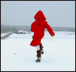 Girl running in red jacket